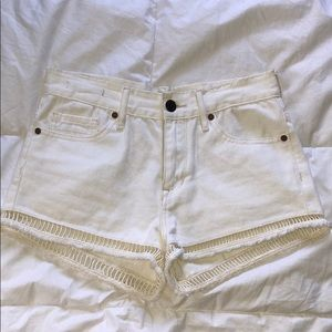 Kendall and Kylie distressed white shorts